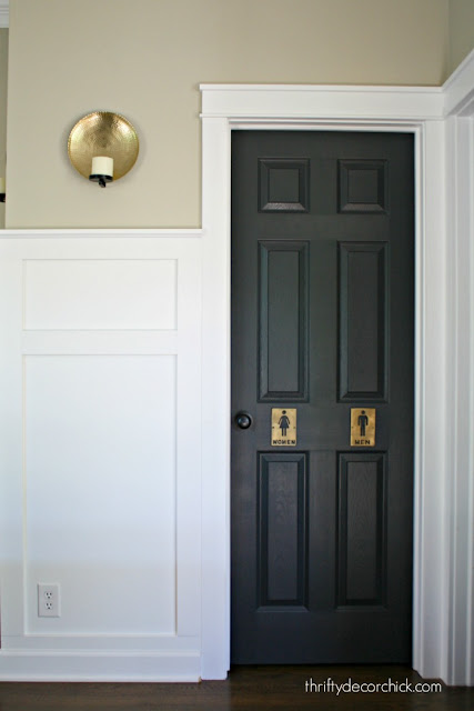 White walls and trim, black door