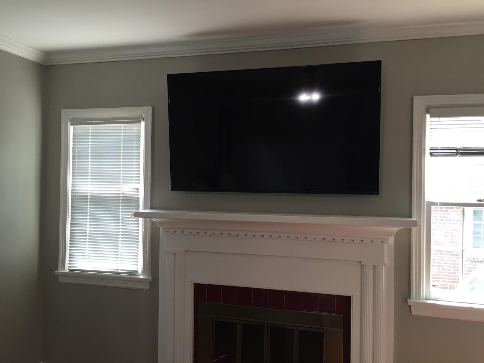 TV Wall Mounting Charlotte NC: TV Mounted on Brick Fireplace
