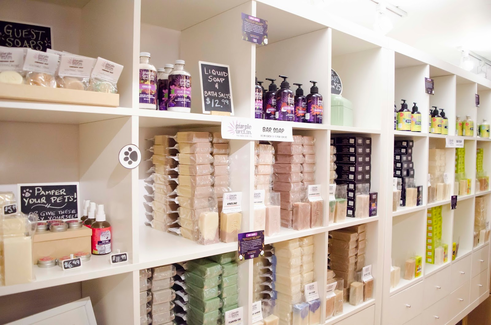 Hundreds of handmade skincare products on a shelf in Purple Urchin's store