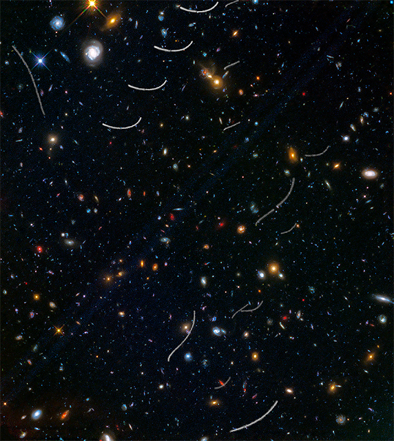 Hubble sees nearby asteroids photobombing distant galaxies
