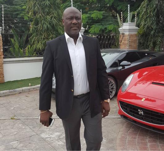 Senator Dino Melaye poses beside his impressive garage