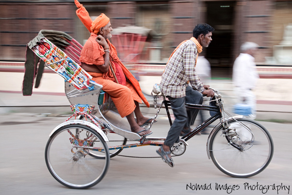 indian sadhu travelling by cycle rickshaw