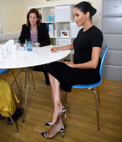 Meghan Markle wore Hatch Eliza dress, Oscar de la Renta coat, Gianvito Rossi pumps, Kimai Felicity earrings, carried Victoria Beckham clutch