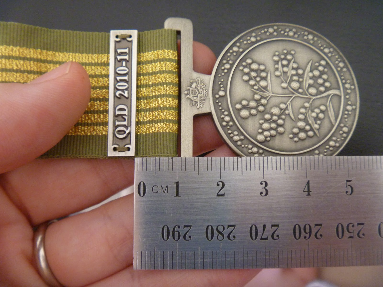 How to sew a clasp to a medal