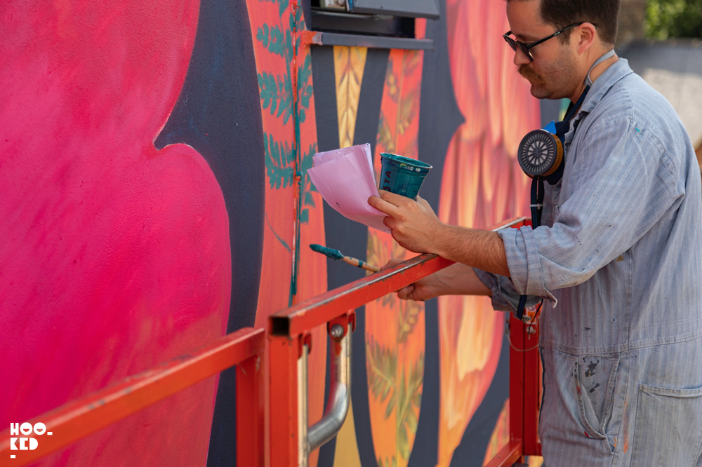 US artist Beau Stanton at work on his mural in Walthamstow, London