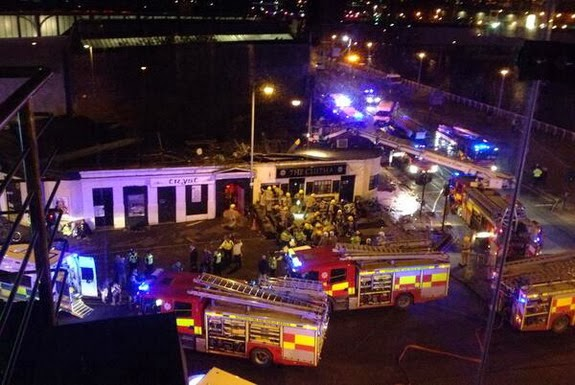 Scottish Fire and Rescue services attend the scene following the helicopter crash at the Clutha Bar