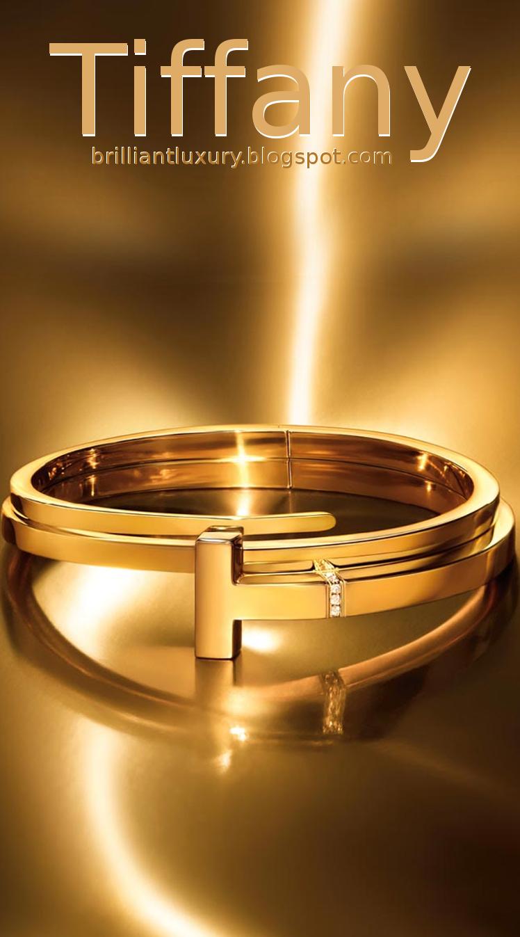 Brilliant Luxury ♦ Tiffany T hinged wrap bracelet in 18k gold with diamonds