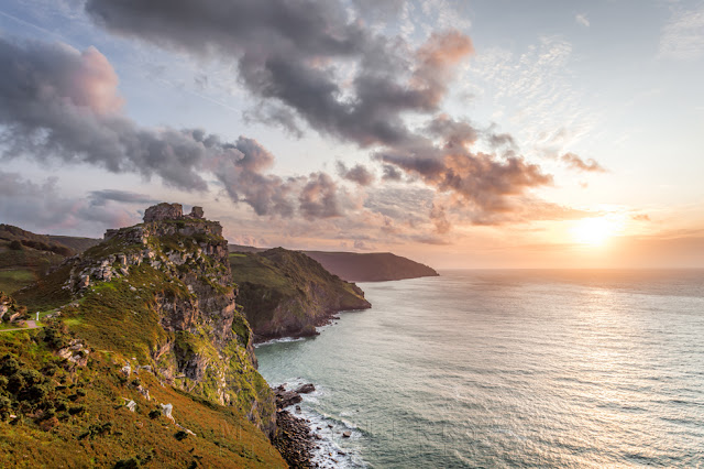 Exmoor coastline at the Valley of Rocks with a beautiful sunset sky above