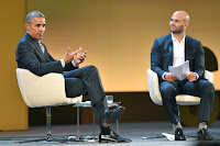 Former President Barack Obama talked with Sam Kass about the effect of agriculture on climate change at the Seeds & Chips conference on Tuesday in Milan. (Credit: Andreas Solaro/Agence France-Presse — Getty Images) Click to Enlarge.
