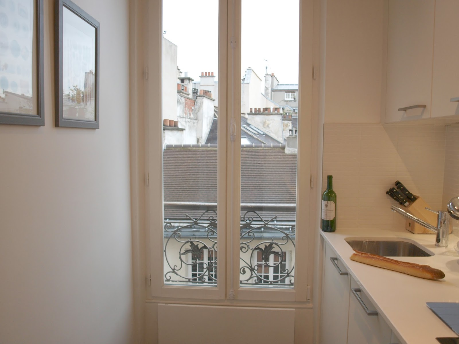 Modern white kitchen in our Paris apartment - Hello Lovely Studio