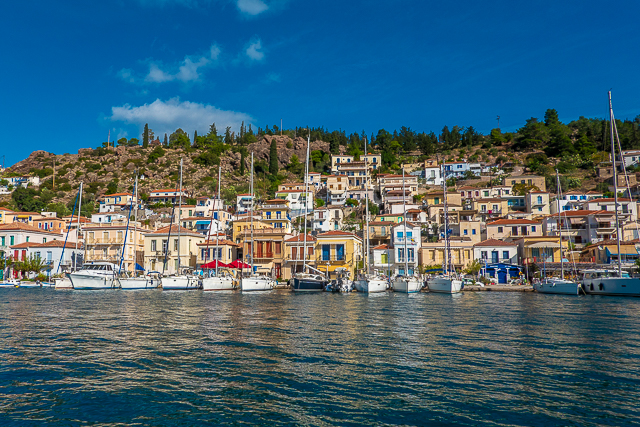 Why you should go to Poros, Greece - AHI Travel tour - where to stay, what to do and where to eat. The beach, the sunsets and food! Poros is a must on your trip to Greece!