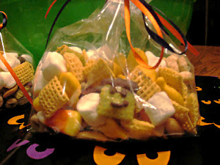close up of snack mix in a bag with orange ribbon