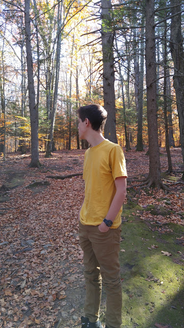 a boy in the woods