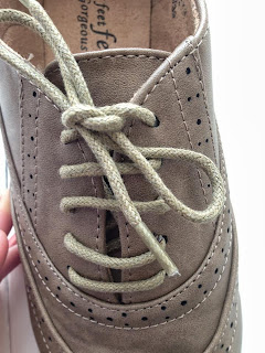 close up detail of the shoelaces on the brogues