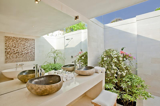 Picture of stone sinks in the modern tropical bathroom