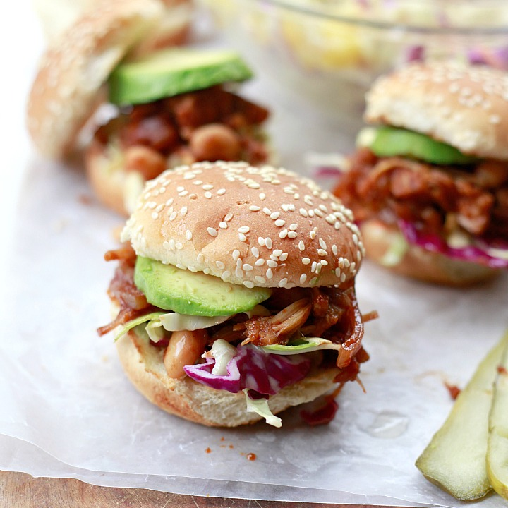 Easy BBQ pulled jackfruit and bean sandwiches made in the slow cooker or crockpot and served with slaw and avocado. These delicious jackfruit sandwiches are vegetarian and vegan.