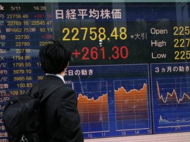 Asian markets fall, dollar rises as US rate fears return