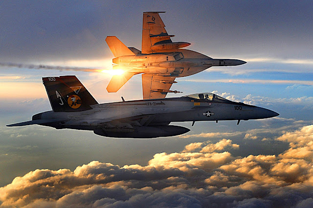 Two F/A-18 Super Hornets in flight