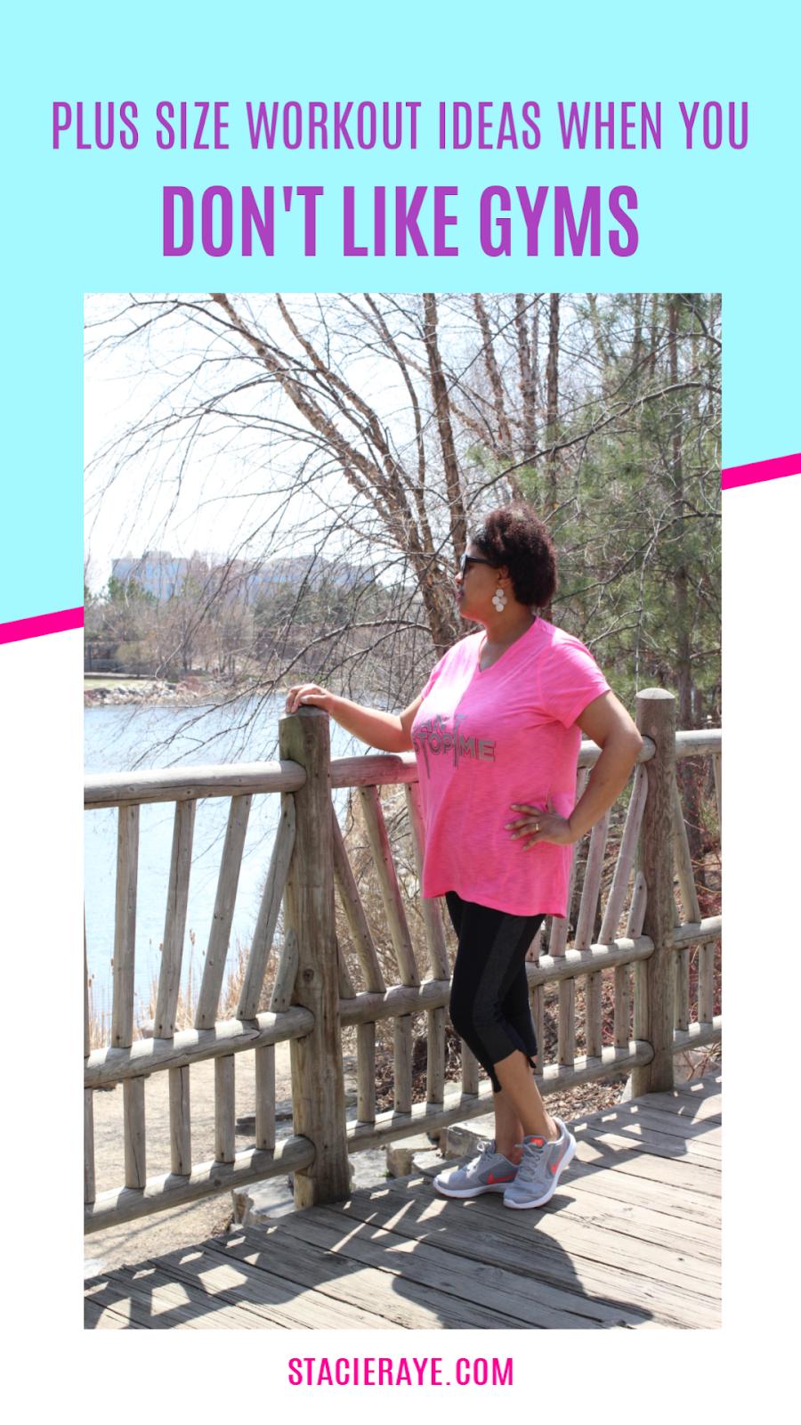 a woman standing next to a bridge