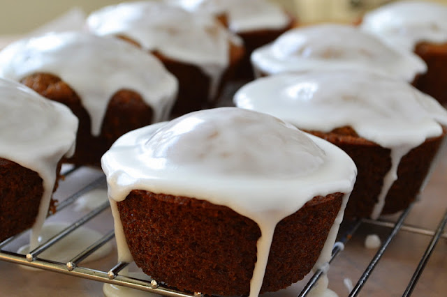 Gingerbread muffins with lemon glaze dripping down