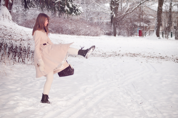 lolita in winter clothes doing a kick in the air