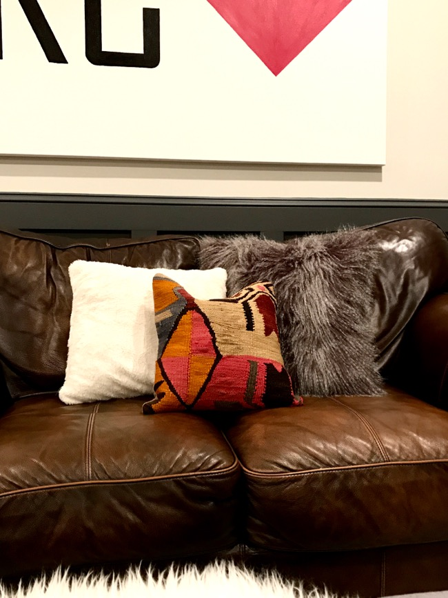 Decorative Pillows For White Leather Couch : Life Love Larson: Leather Sofas + Kilim Throw Pillows