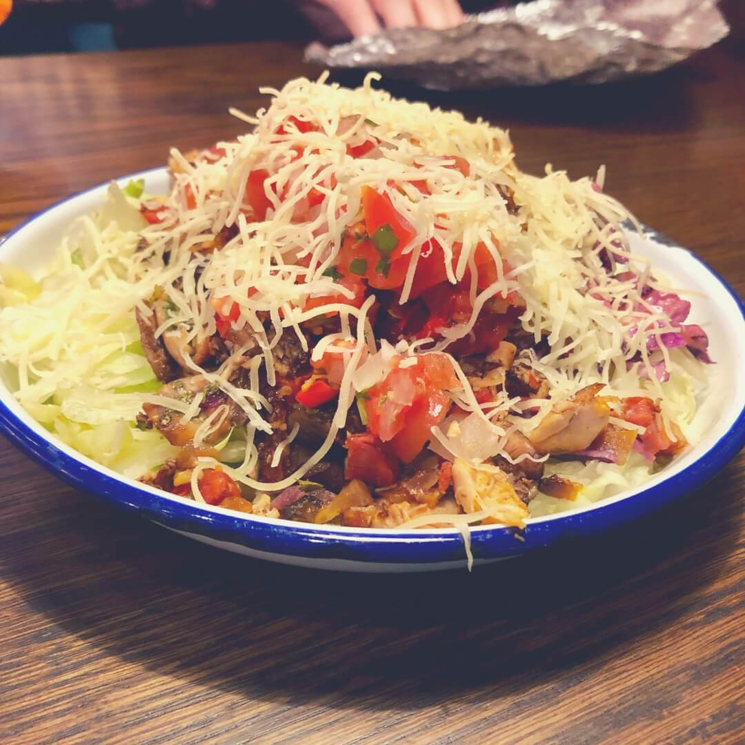 A salad bowl from Barburitto, features grilled chicken and chorizo, mild salsa, mushrooms, lettuce, crunchy slaw, and cheese. Image for Easter lunch at Barburrito Nottingham (and Giveaway!)