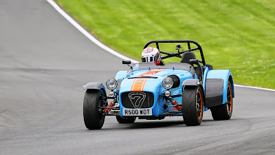 On track at Cadwell Park - great picture showing the orange shocks and wheel rims