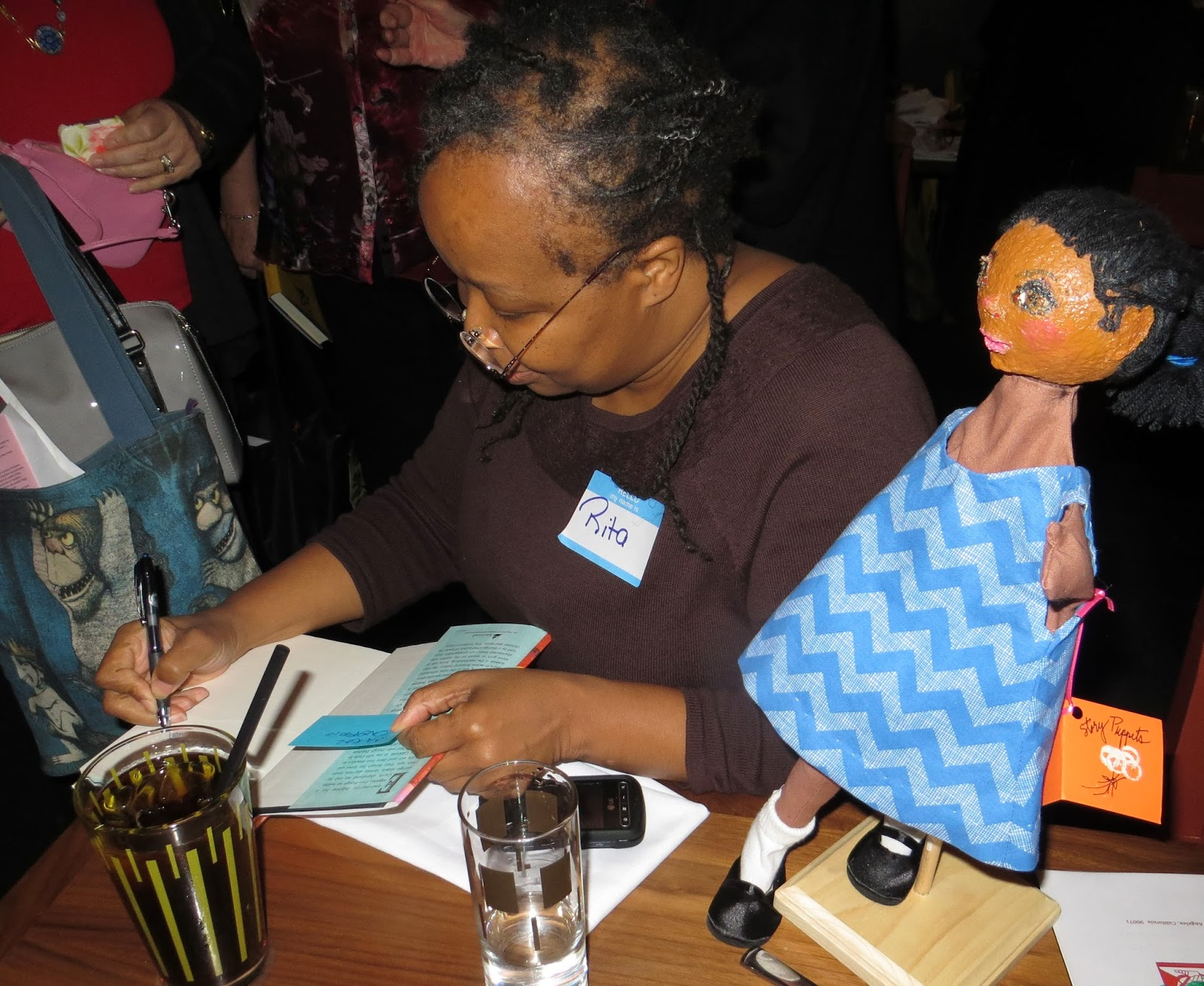 Rita Autographing A Book And Puppet
