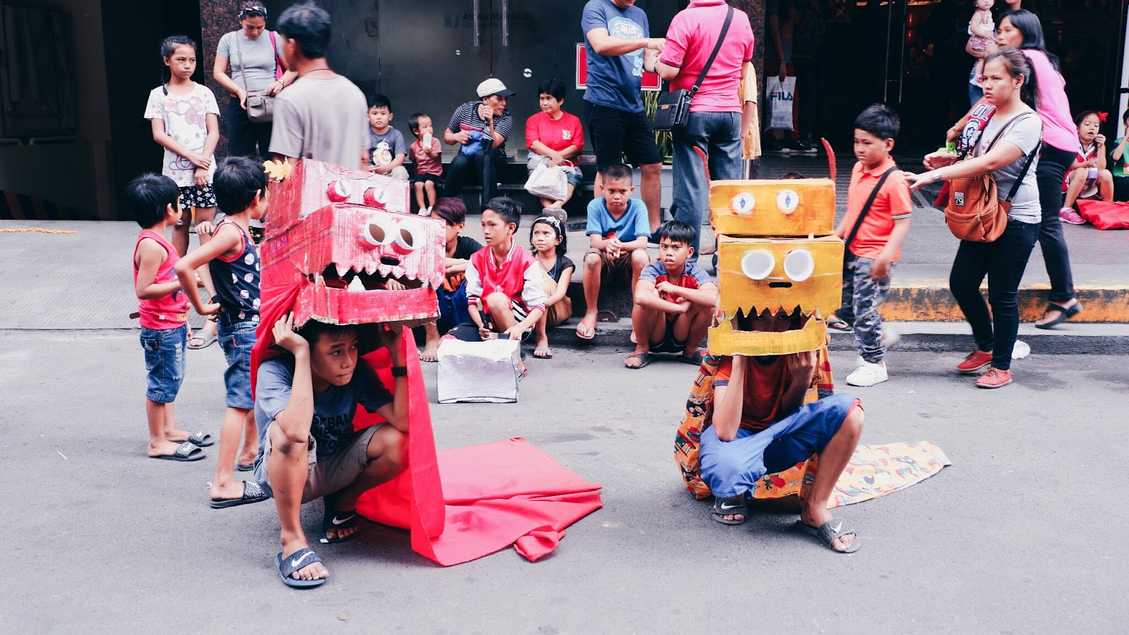 kids dragon dance made of cardboard boxes