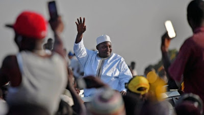 Adama Barrow  returns to Gambia amid tight security by Senegalese and Nigerian  soldiers #Gambia