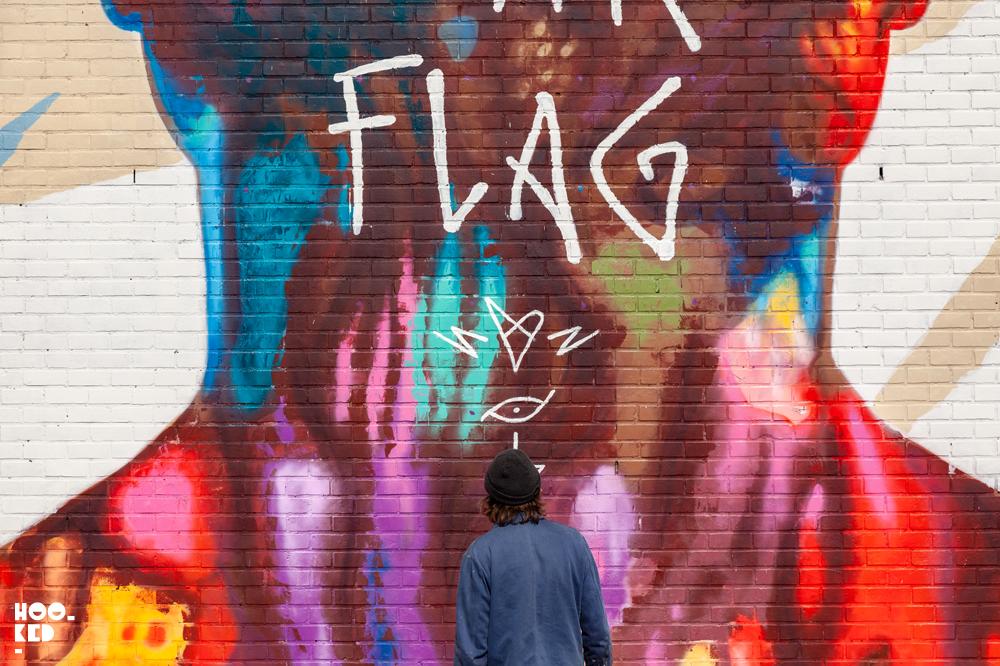 Artist David Walker in front of his mural in Ostend, Belgium
