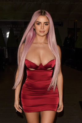 Demi Rose Flaunts Her Figure In A Tight Dress Whiles She Steps Out In London.