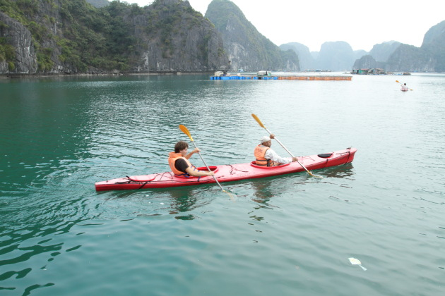 Kayaking in misty Halong Bay, Vietnam