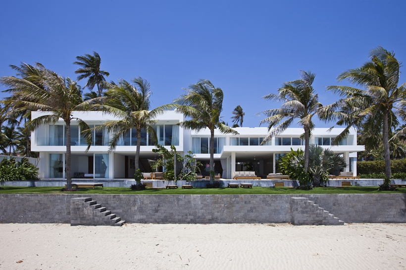 Modern house and palm trees from the beach