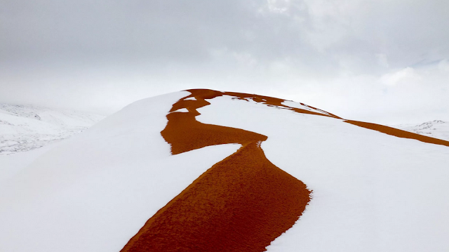 بالفيديو الثلوج تزين الصحراء الافريقية مناظر خلا بة