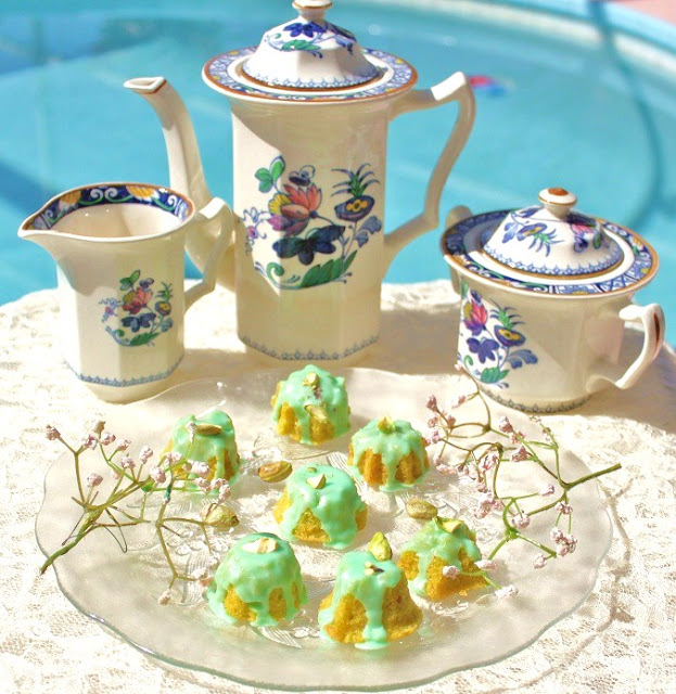 grandma's tea set Little pistachio tea cakes with frosting, flowers on a antique plate