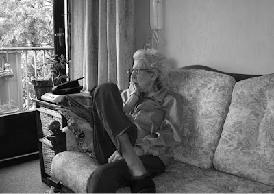 image from  Snapshots by Corina Duyn, with photo of Miep Duyn, 85, on her couch