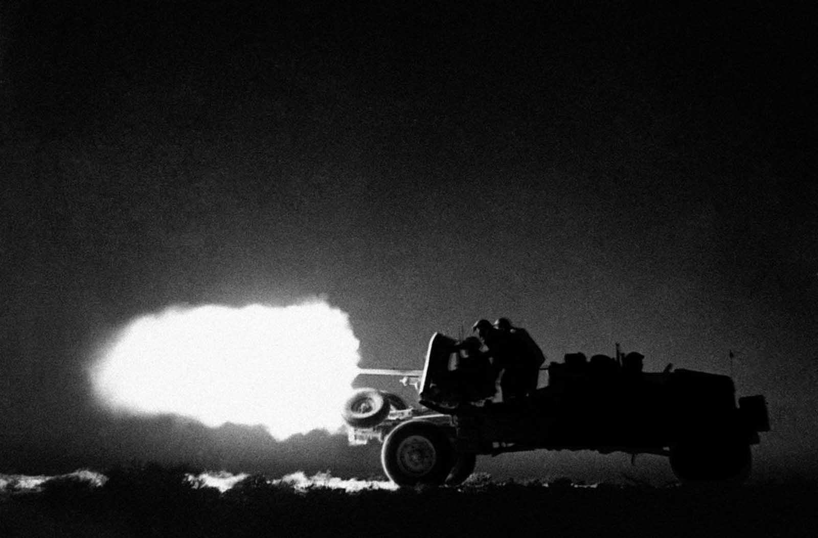 Truck-mounted anti-tank guns, used as highly mobile, hard-hitting artillery units, speed over the desert and attack the enemy from all sorts of unexpected quarters. A mobile anti-tank unit of the Eighth Army in action, somewhere in the desert, Libya, on July 26, 1942.