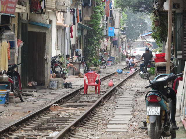 Red plastic chair on train tracks in Hanoi Vietnam
