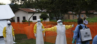 Doctors on Ebola suits