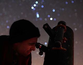 Image of Amateur Astronomer Observing Thru Telescope