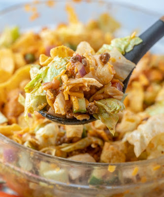 serving spoon full of frito taco salad