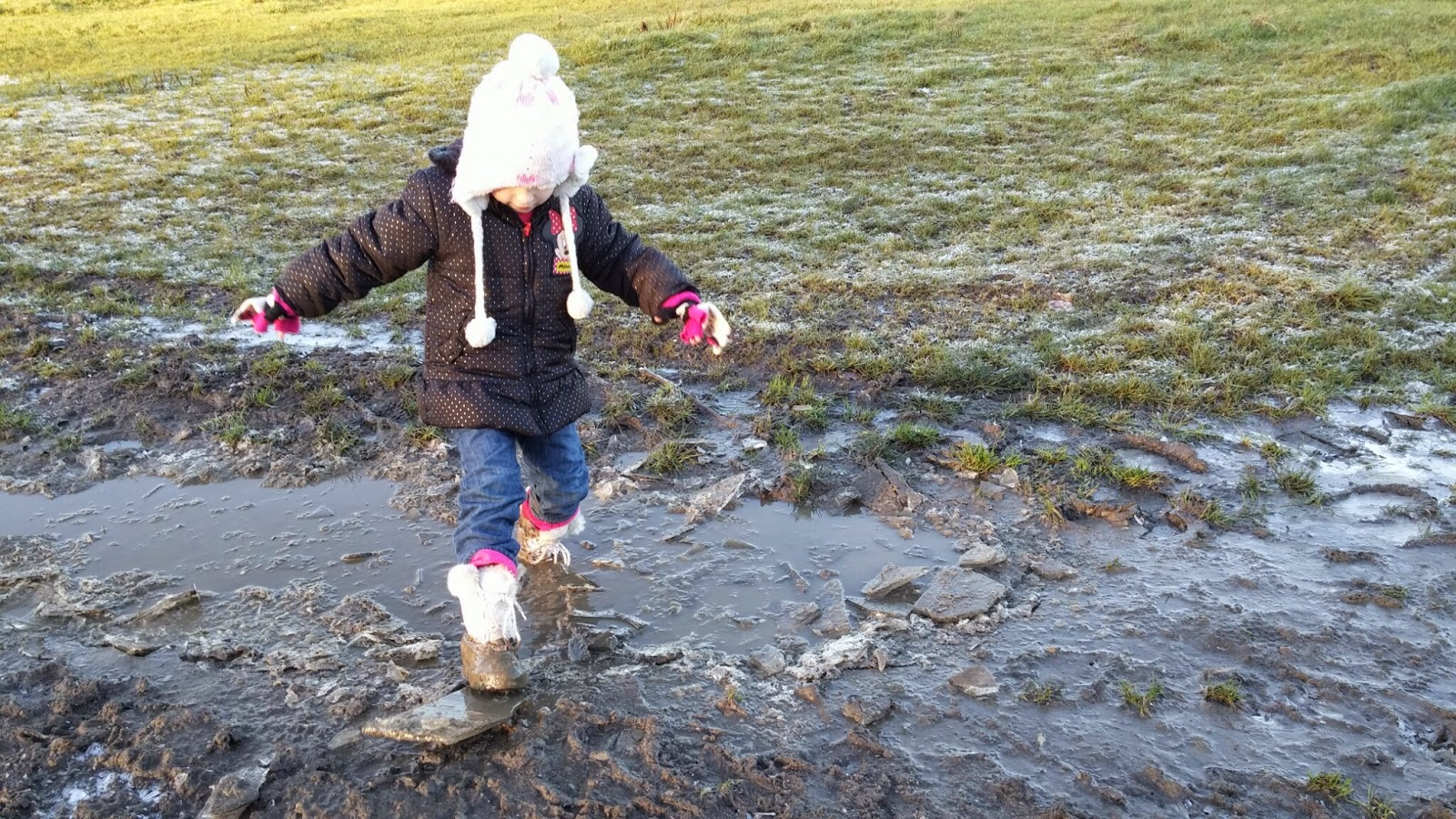 breaking ice to jump in puddles