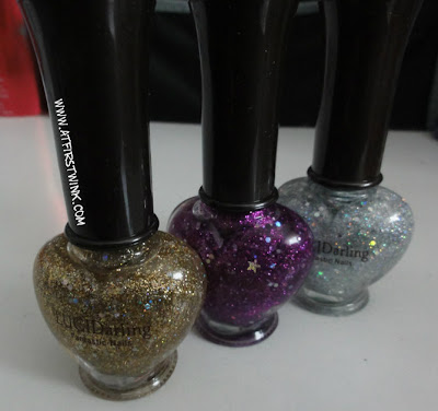 Etude House glitter nail polishes in gold, purple and silver.