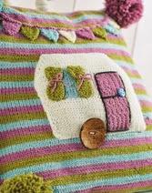 http://www.letsknit.co.uk/free-knitting-patterns/cute-caravan-cushion