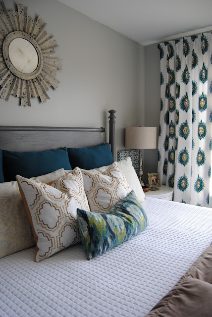 master bedroom, bedroom, bedding, how to make a bed, teal, teal bedding, white bedding, sunburst mirror, mirror over bed