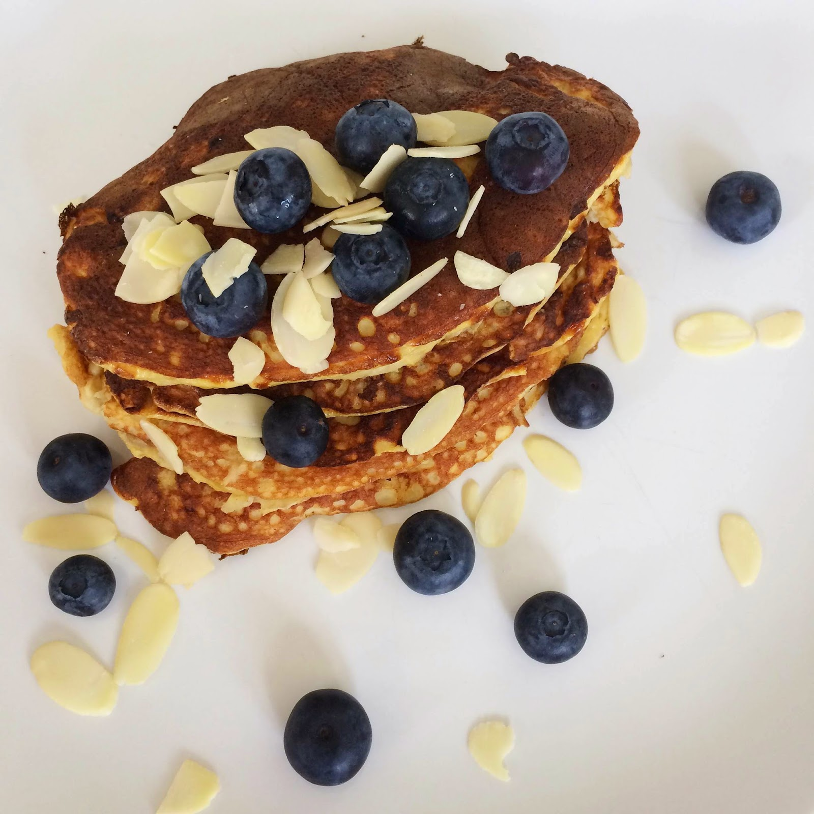 clean healthy banana pancakes blueberries almond flakes