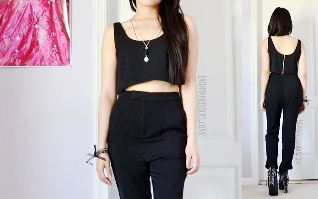 A bold, sleek, minimalistic outfit featuring the Queen Bee crop top and high-waisted ankle pants set from Tobi, worn with a grunge-style layered necklace and Jeffrey Campbell Lita spike platform booties dupes.