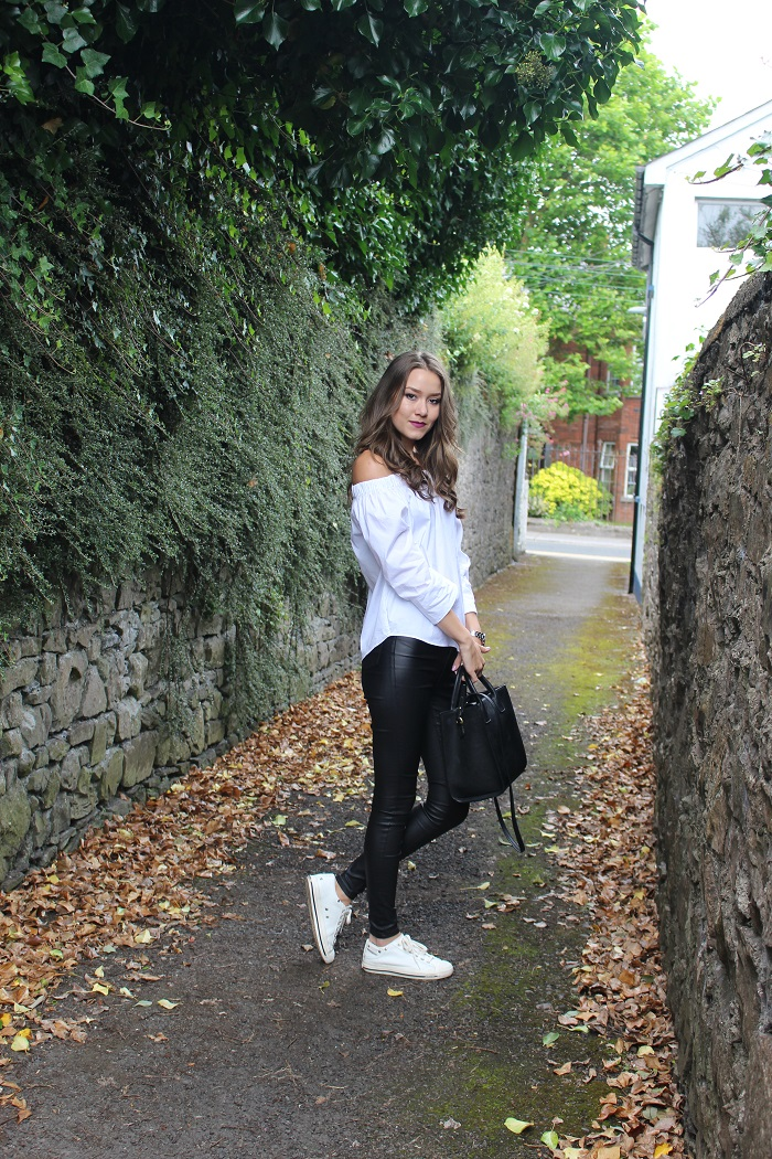 white top and faux leather trousers